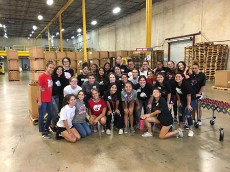 Girls' Volleyball Volunteering at Food Bank